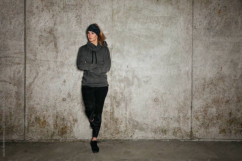 Female runner resting after workout by Jacob Ammentorp Lund for Stocksy United