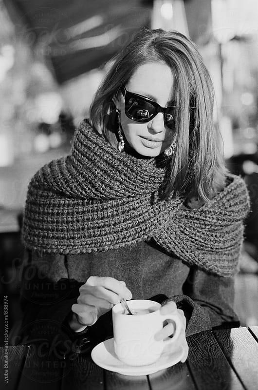 Woman drinking coffee outdoors by Lyuba Burakova for Stocksy United