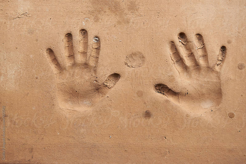 Handprint on cement wall by Guille Faingold for Stocksy United