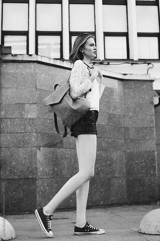 Young woman standing in front of urban building by Lyuba Burakova for Stocksy United