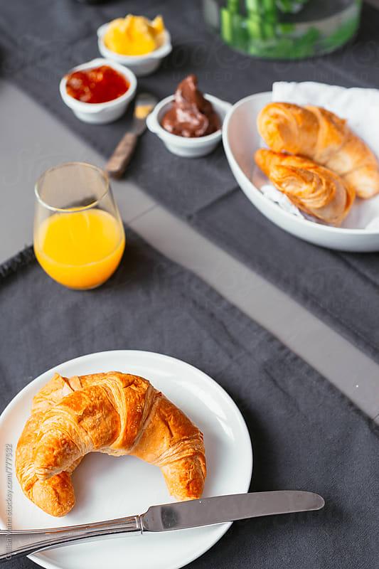 croissant for breakfast by Gillian Vann for Stocksy United
