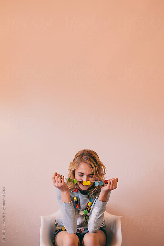 Beautiful Girl with Garland Around Neck by Gabrielle Lutze for Stocksy United