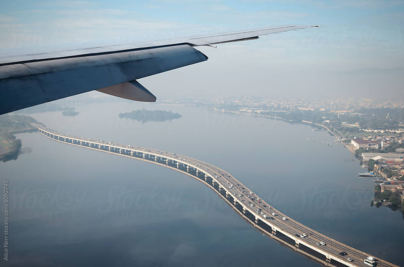 Airplane wing above Rio de Janeiro by Alice Nerr for Stocksy United