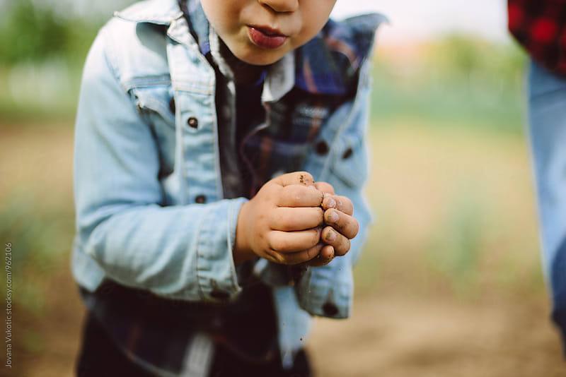 Boy in garden by Jovana Vukotic for Stocksy United