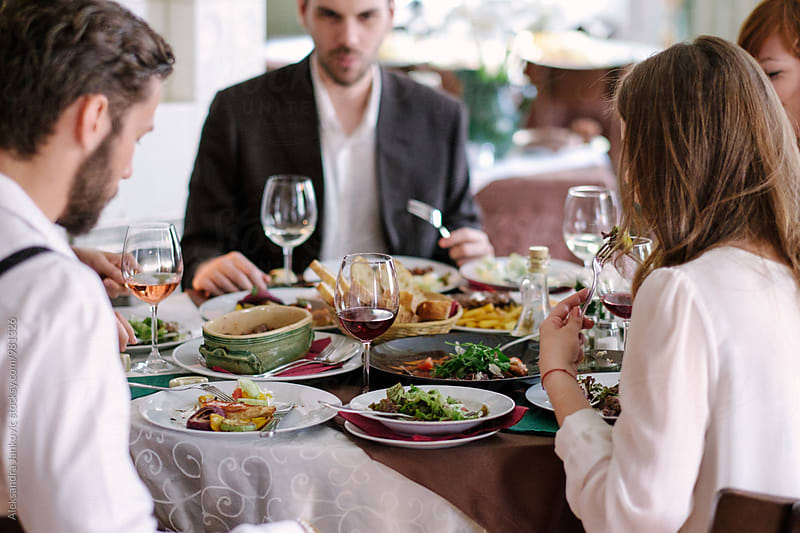Group of Friends Having Lunch at the Restaurant by Aleksandra Jankovic for Stocksy United