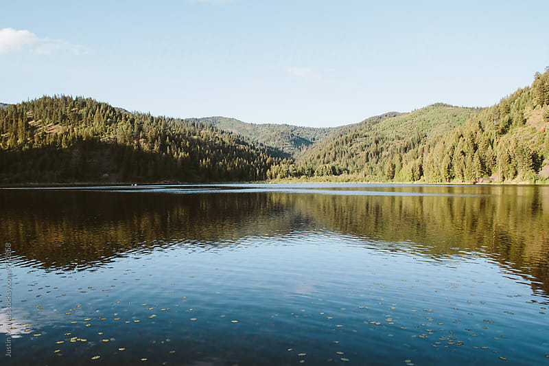 Panoramic photo of mountain lake by Justin Mullet for Stocksy United
