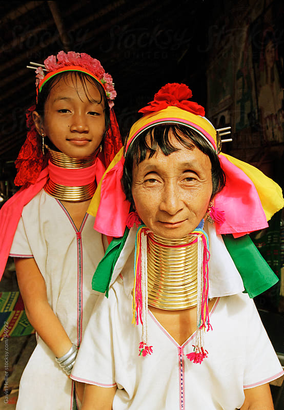 Portrait of two Long necked Padaung tribe women, Mae Hong Son Province, northern Thailand by Gavin Hellier for Stocksy United
