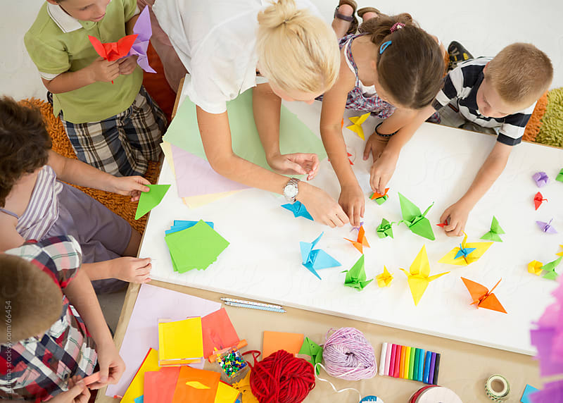 Kindergarten Workshop: Children Making Origami Birds by Lumina for Stocksy United