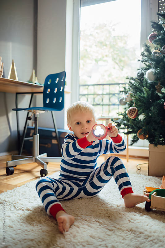 Happy Boy Plays in His Room at Christmastime by Lumina for Stocksy United