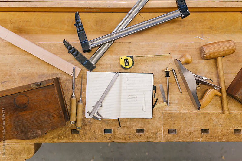 Topshot of a workbench with a design and tools on it by Ivo de Bruijn for Stocksy United