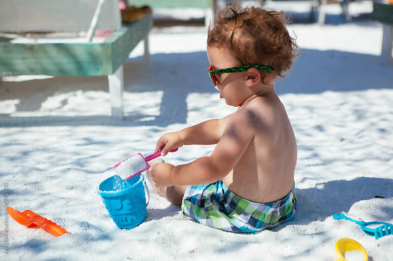 Toddler playing at the beach by Ani Dimi for Stocksy United