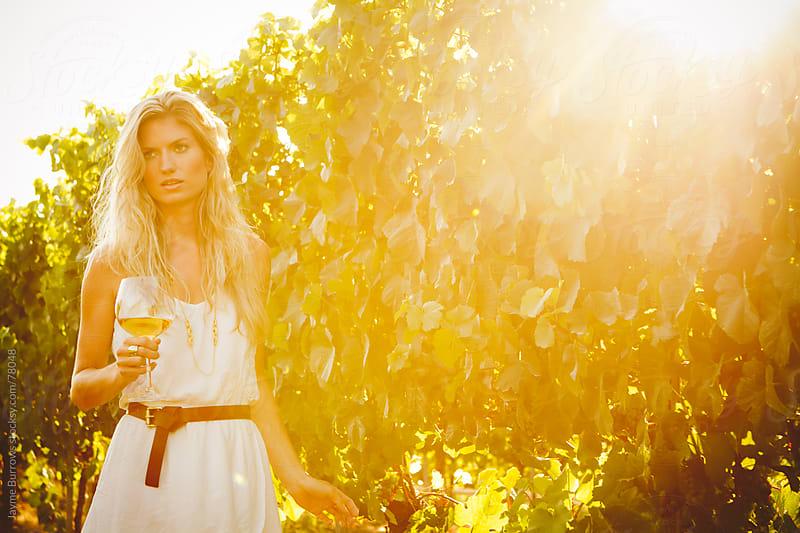 Woman in Vineyard by Jayme Burrows for Stocksy United