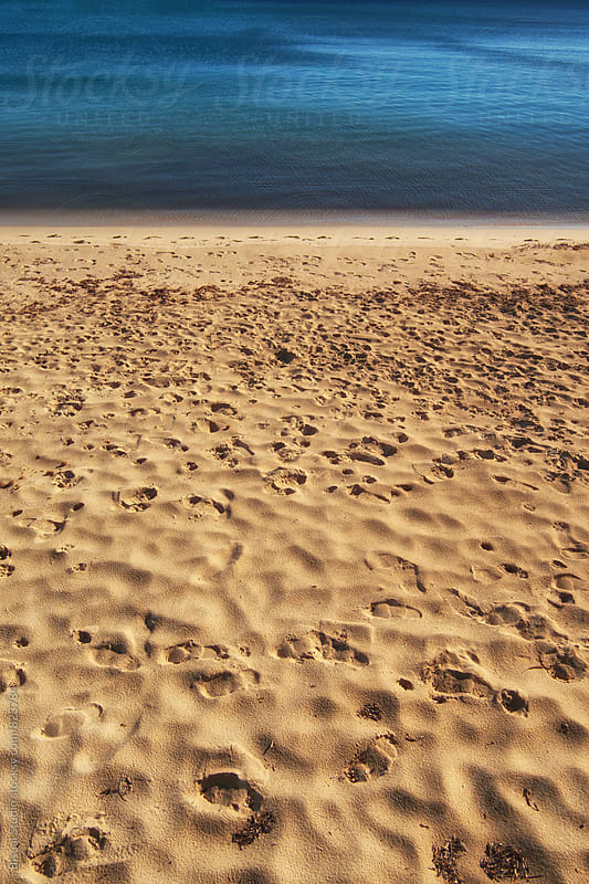 Footprints on the beach, Ibiza  by Bisual Studio for Stocksy United