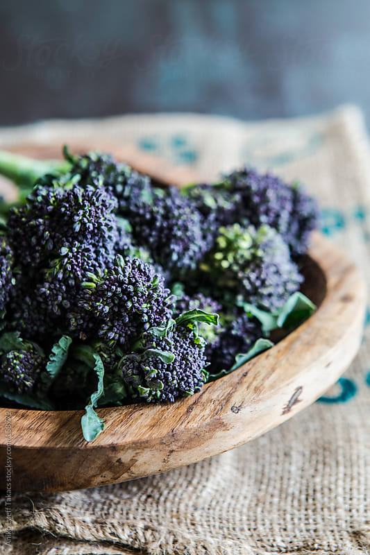Purple Sprouting Broccoli on a wooden plate by Aniko Lueff Takacs for Stocksy United