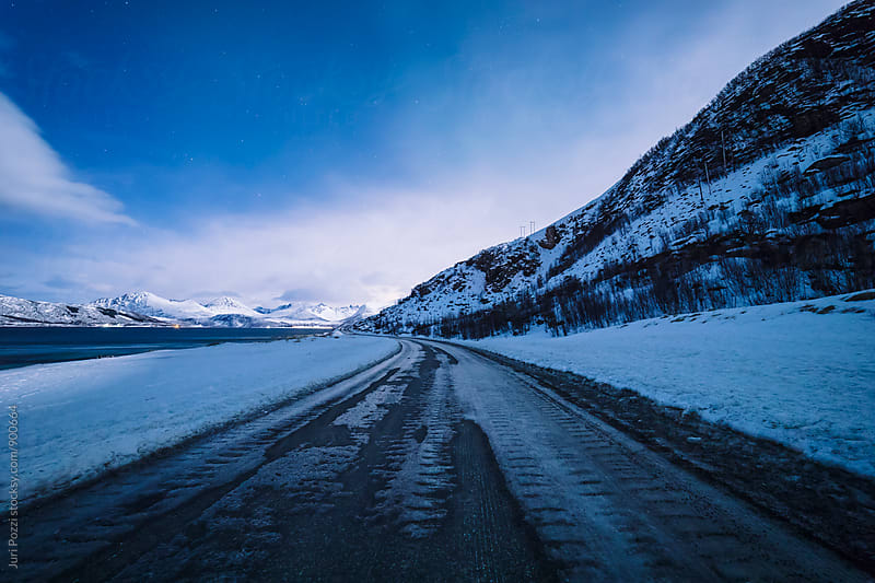 iced road along e norwegian fjord by Juri Pozzi for Stocksy United