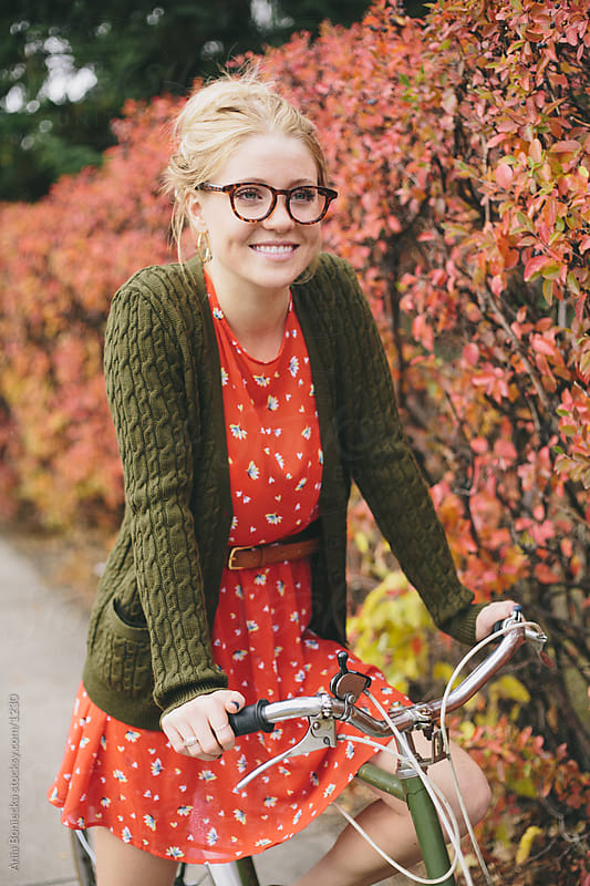 On her bike in the fall by Ania Boniecka for Stocksy United