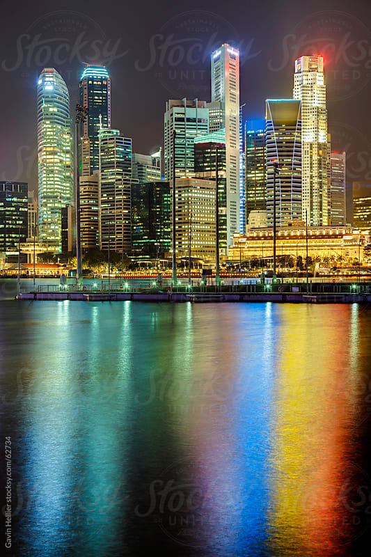 Singapore City Skyline illuminated at dusk by Gavin Hellier for Stocksy United