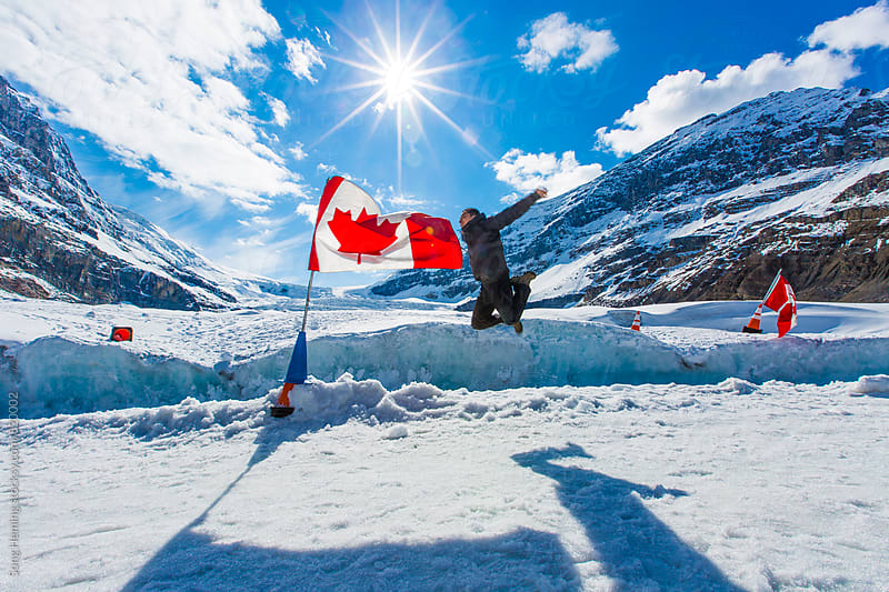man at icefield by Song Heming for Stocksy United