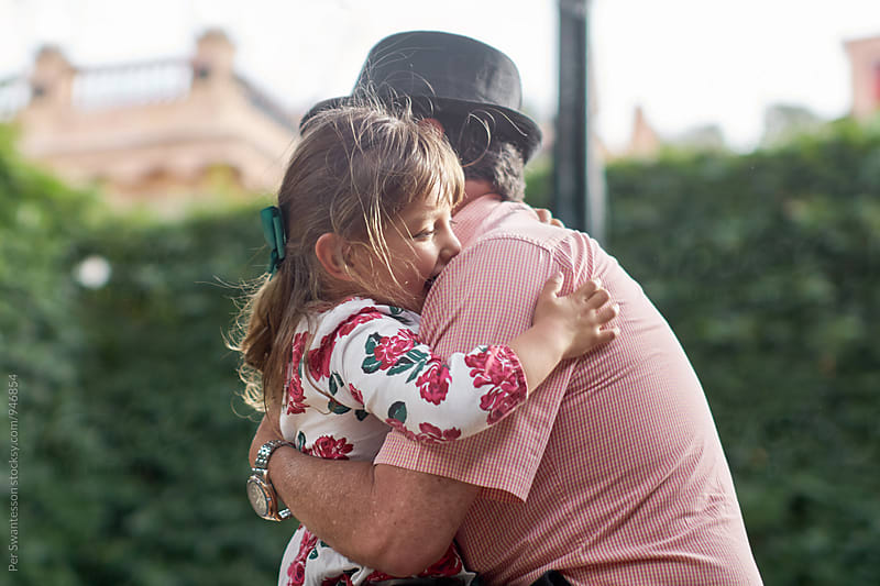 Toddler and her granddaddy hugging by Per Swantesson for Stocksy United