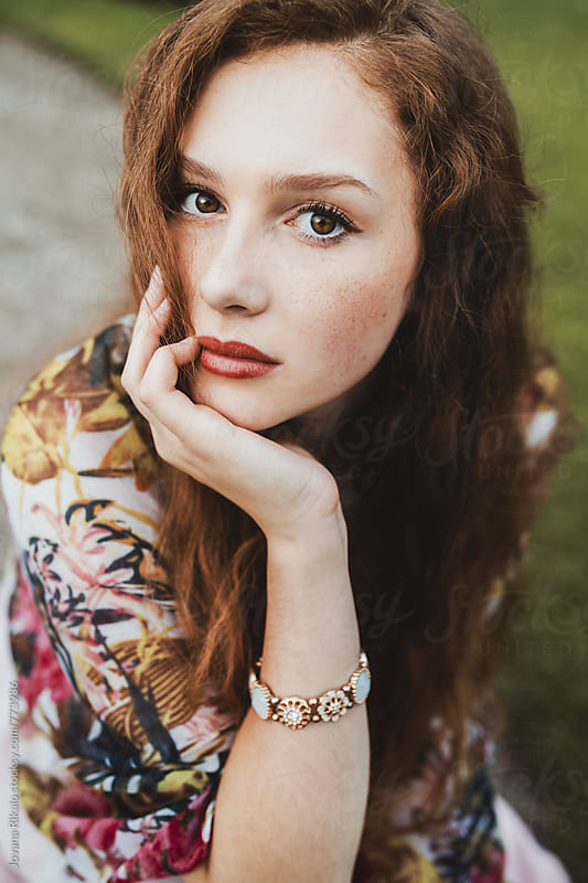 Portrait of a young woman with freckles by Jovana Rikalo for Stocksy United