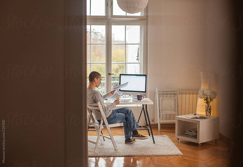 Man Working in His Home Office by Mosuno for Stocksy United