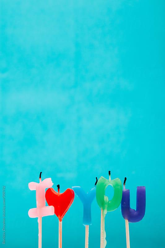 Candles I Love You on Blue Background by Borislav Zhuykov for Stocksy United