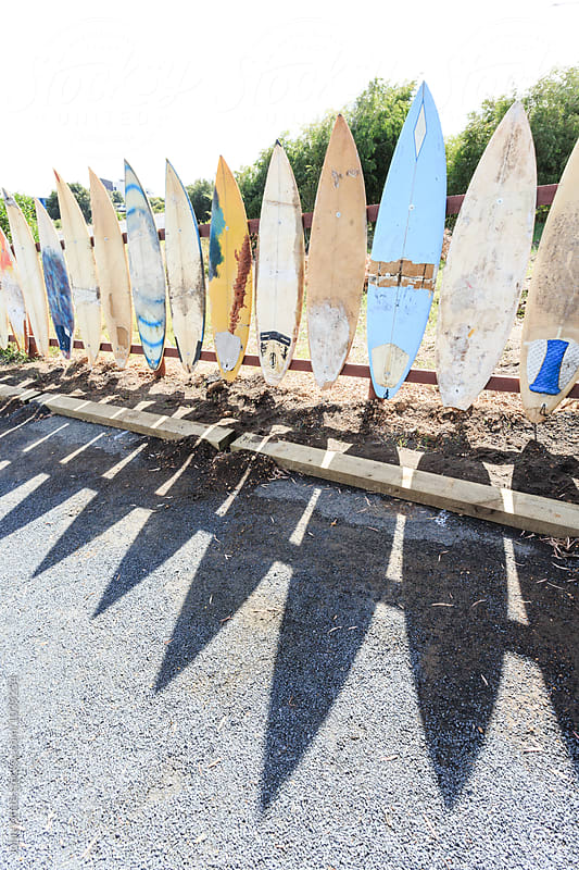 A fence of old surfboards. Prevelly. Western Australia. by John White for Stocksy United