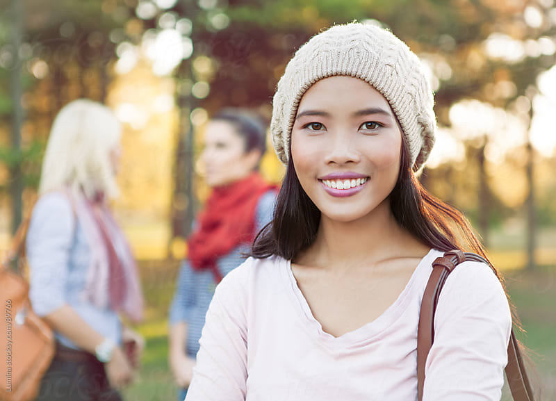 Smiling Asian Woman Outdoors by Lumina for Stocksy United