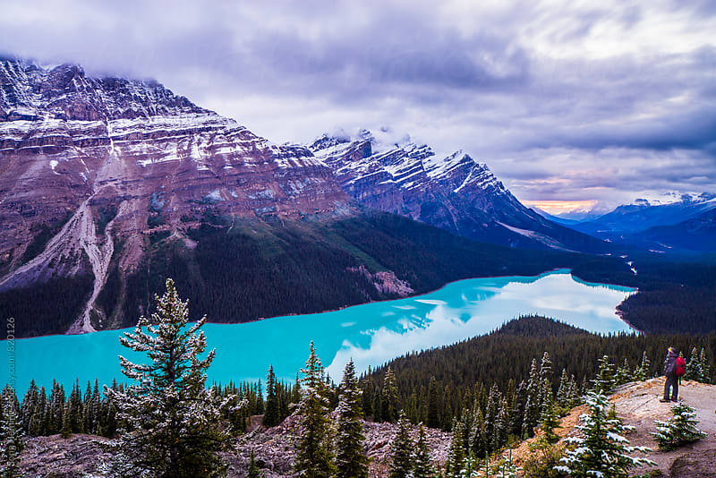 travller and Peyto Lake at sunset by Song Heming for Stocksy United