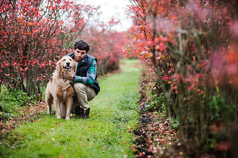 Man with his dog outdoor by Suprijono Suharjoto for Stocksy United