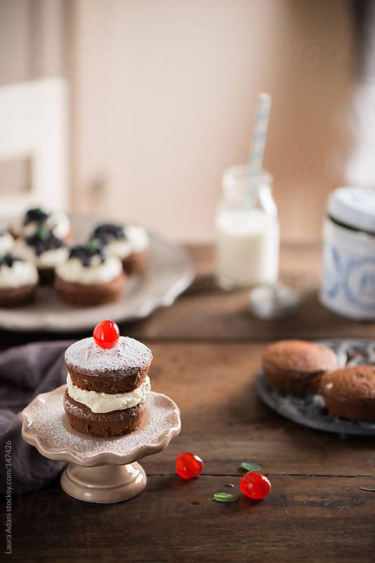 chocolate mini cake stuffed with cream by Laura Adani for Stocksy United