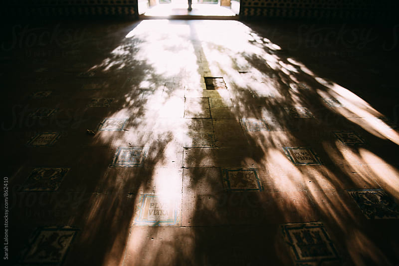 light through a window of the alcazar of seville  by Sarah Lalone for Stocksy United