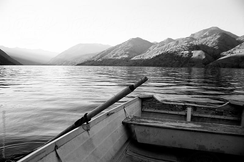 Row boat on lake by Jeff Marsh for Stocksy United