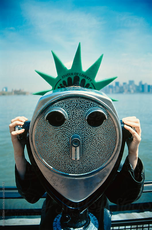 Woman wearing liberty crown using viewer, Liberty Island. New York. by Hugh Sitton for Stocksy United