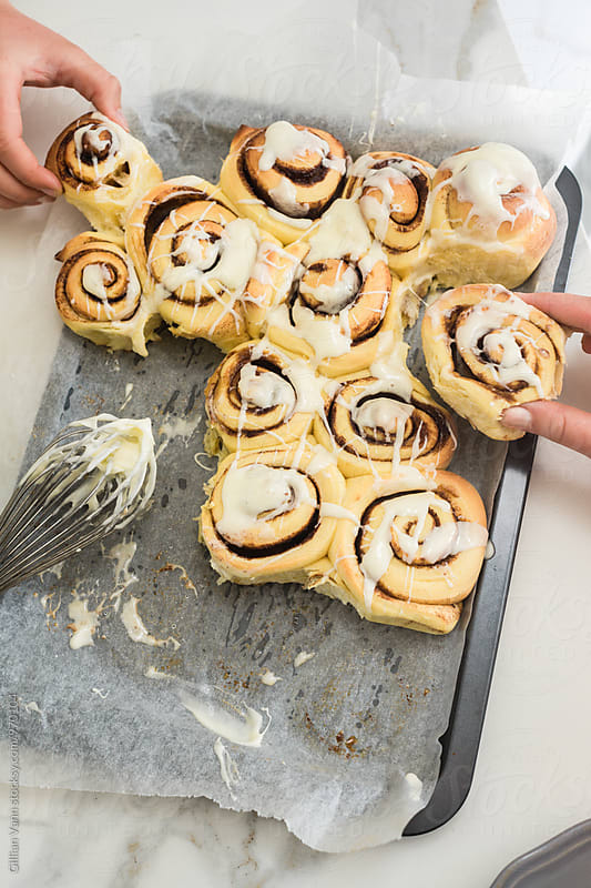 warm cinnamon buns don't last long by Gillian Vann for Stocksy United
