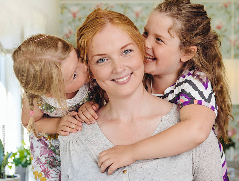 happy mother with her daughters at home by Andreas Gradin for Stocksy United