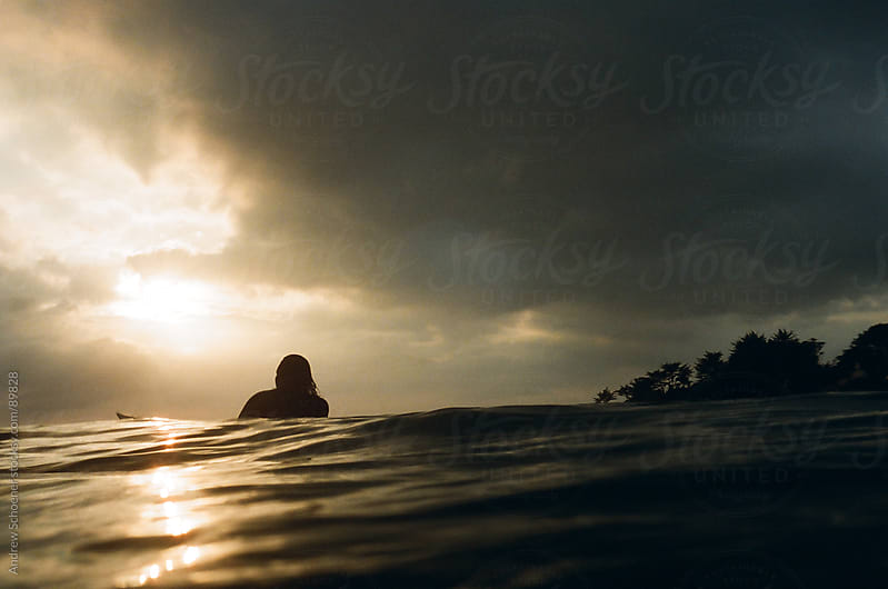 surfer and sunset by Andrew Schoener for Stocksy United