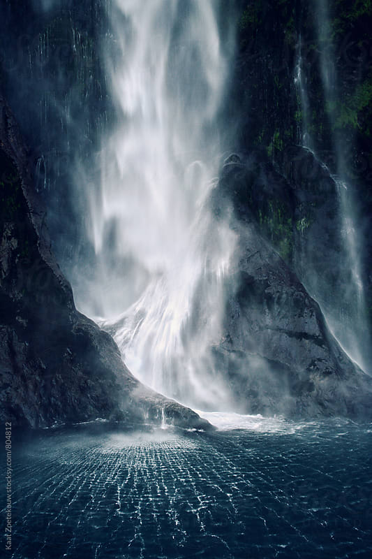 Gushing, moody waterfall in New Zealand's fjord (sound) region. by Kaat Zoetekouw for Stocksy United