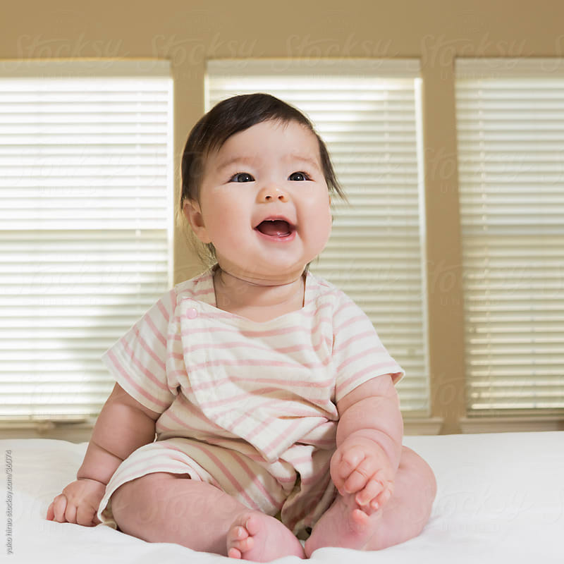 Laughing baby girl portrait by yuko hirao for Stocksy United