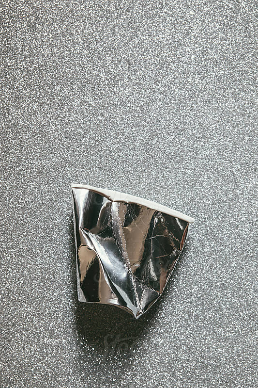 Destroyed silver paper glass by Vera Lair for Stocksy United