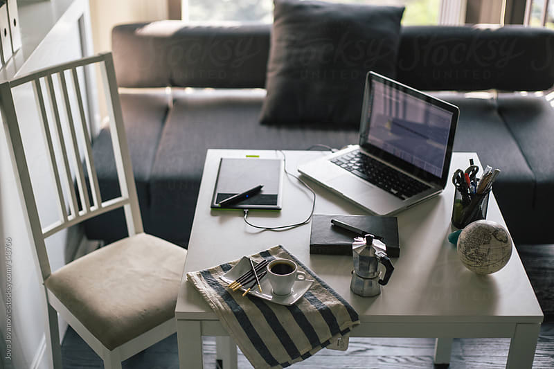 Designers working desk with morning coffee. by Jovo Jovanovic for Stocksy United