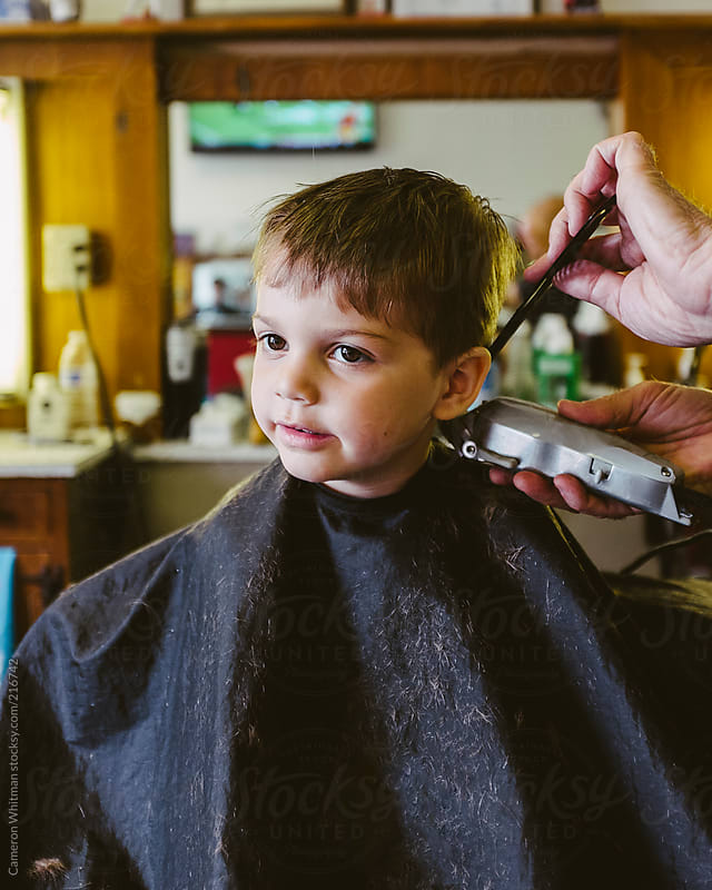 Handsome Young Boy Getting His Haircut In A Barbershop By Cameron Whitman For Stocksy United
