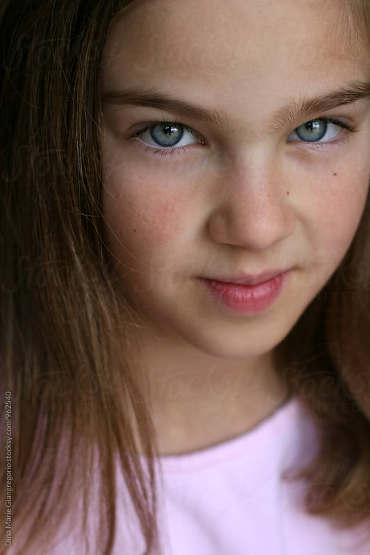 Portrait Of Beautiful Blue Eyed Girl Wearing Pink by Dina Giangregorio for Stocksy United