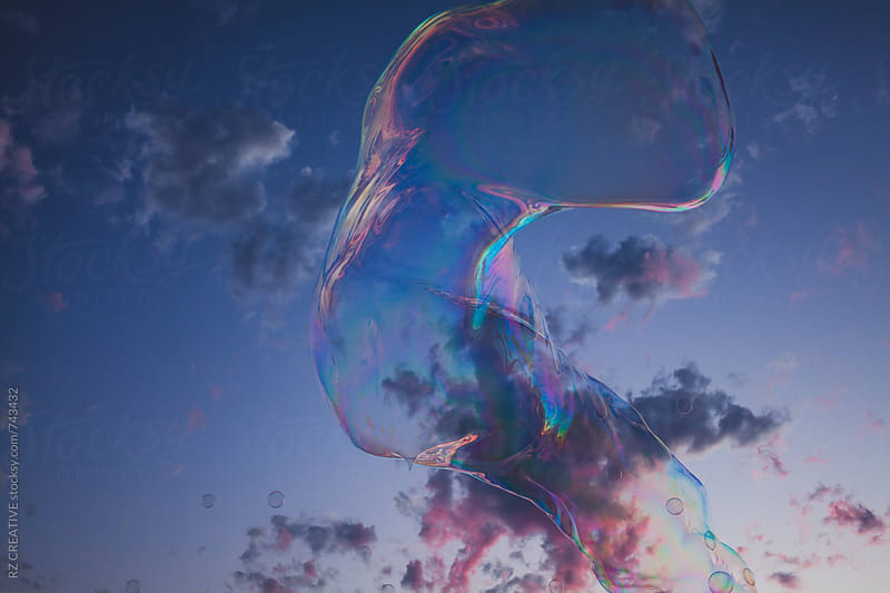 Large bubble floating along the beach at sunset. by RZ CREATIVE for Stocksy United