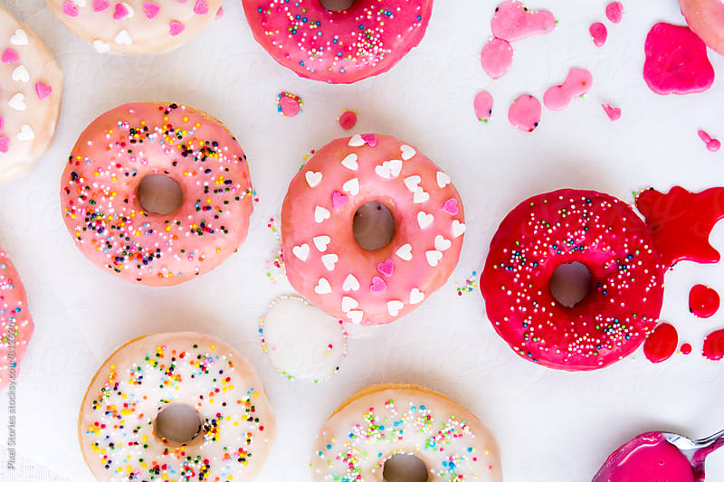 Glazing donuts by Pixel Stories for Stocksy United
