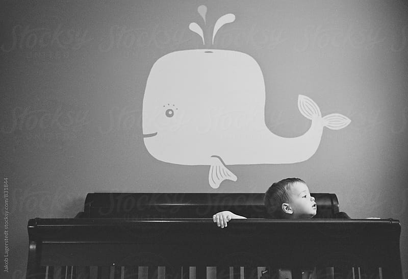 Cute toddler standing in his crib  by Jakob for Stocksy United