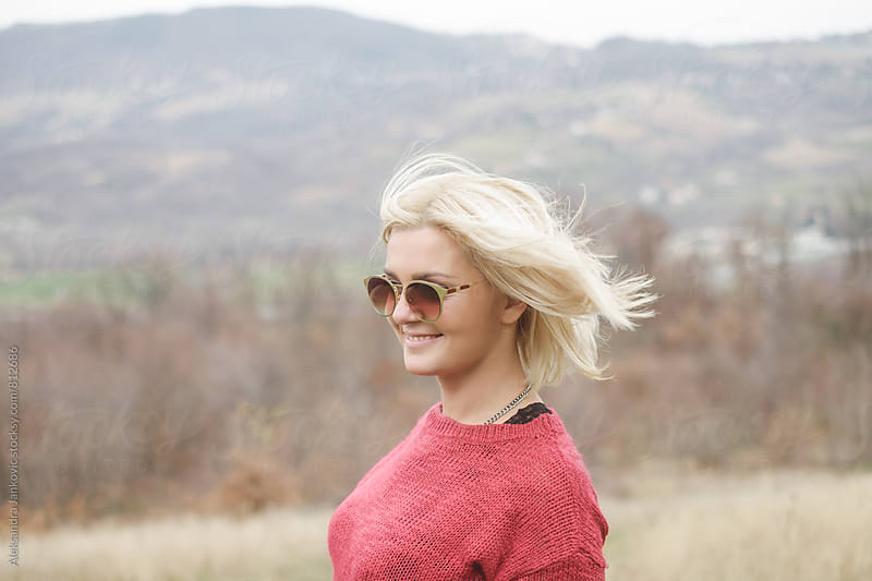 Portrait of a Smiling Blond Woman with Sunglasses by Aleksandra Jankovic for Stocksy United