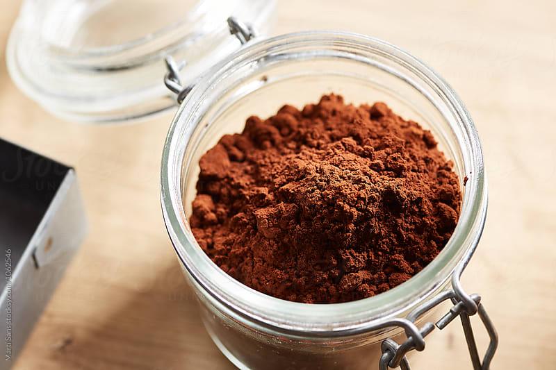cocoa powder in glass jar by Martí Sans for Stocksy United