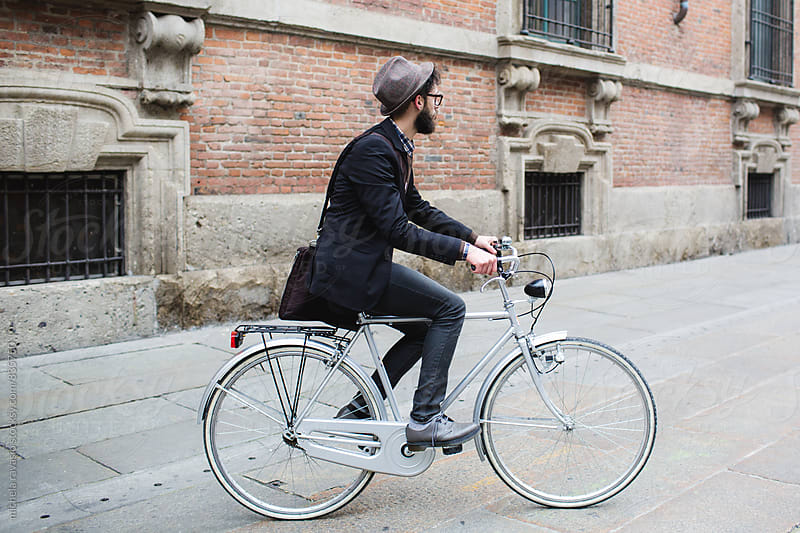 Hipster biking in the city by michela ravasio for Stocksy United