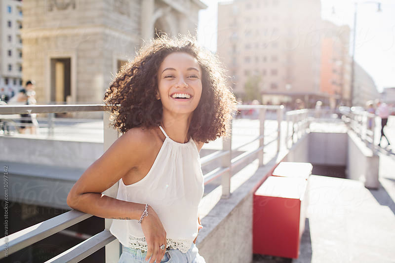 Happy woman in the city on a summer day by michela ravasio for Stocksy United